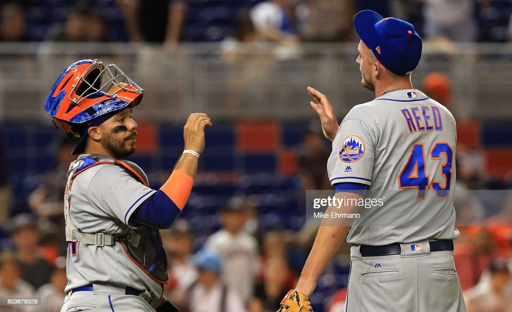 Addison Reed #43 and Rene Rivera #44 of the New York Mets high five after winning a game against the Miami Marlins at Marlins Park on June 29, 2017 in Miami, Florida.