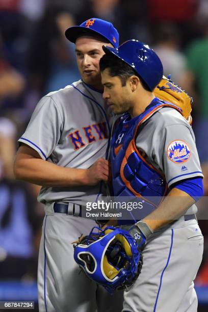 Addison Reed and Travis d'Arnaud of the New York Mets celebrate after defeating the Philadelphia Phillies 45 at Citizens Bank Park on April 12 2017...