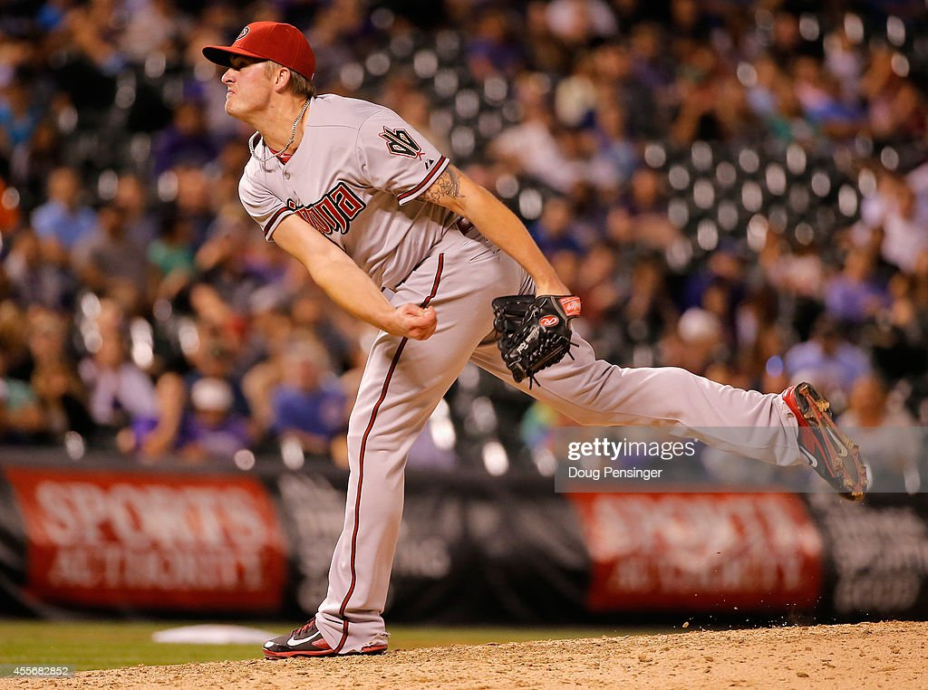 Addison Reed #43 of the Arizona Diamondbacks delivers against the Colorado Rockies at Coors Field on September 18, 2014 in Denver, Colorado. Reed collected the loss after giving up a walk off home run to Wilin Rosario #20 of the Colorado Rockies as the Rockies defeated the Diamondbacks 7-6.