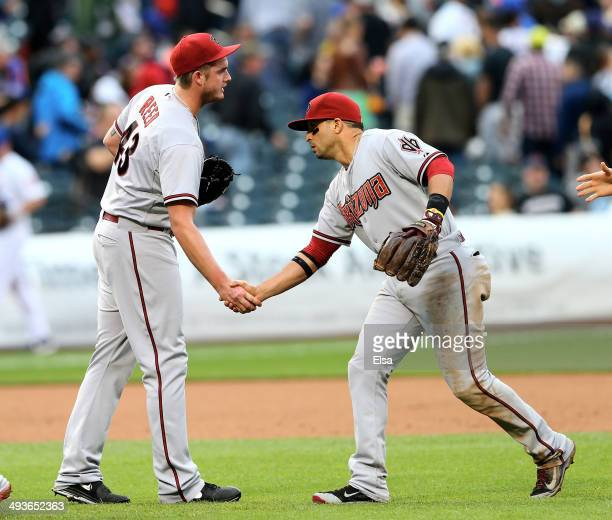 Addison Reed of the Arizona Diamondbacks is congratulated by teammate Martin Prado after the win over the New York Mets on May 24 2014 at Citi Field...