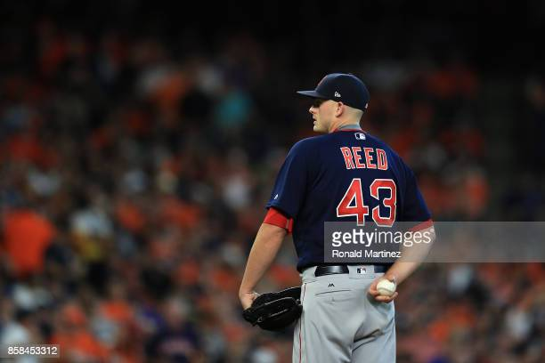 Addison Reed of the Boston Red Sox stands on the pitcher's mound in the sixth inning against the Houston Astros during game two of the American...