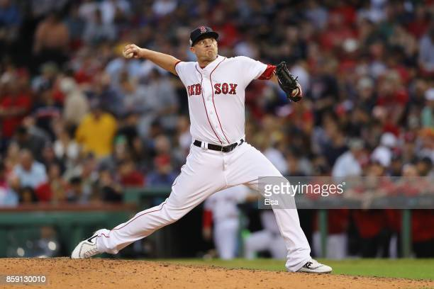 Addison Reed of the Boston Red Sox throws a pitch in the eighth inning against the Houston Astros during game three of the American League Division...
