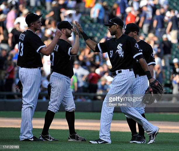 Addison Reed of the Chicago White Sox Jeff Keppinger and Alex Rios celebrate their win against the Atlanta Braves on July 20 2013 at US Cellular...