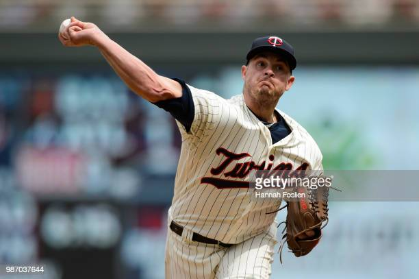 Addison Reed of the Minnesota Twins delivers a pitch against the Texas Rangers during the game on June 23 2018 at Target Field in Minneapolis...
