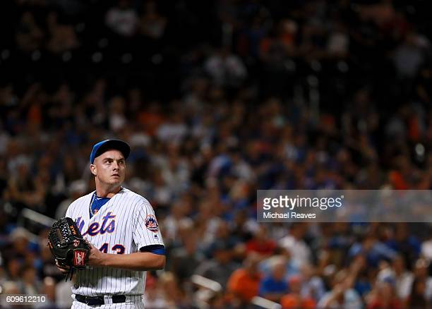 Addison Reed of the New York Mets looks at the scoreboard after being taken out of the game against the Atlanta Braves at Citi Field on September 21...