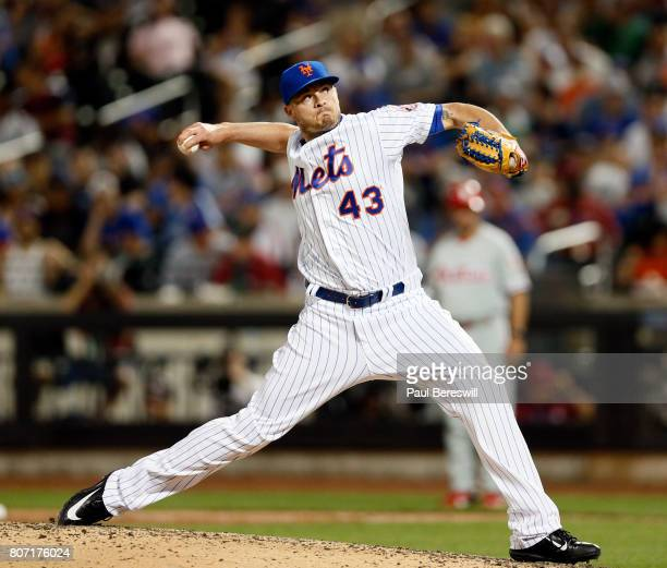 Addison Reed of the New York Mets pitches in an MLB baseball game against the Philadelphia Phillies on June 30 2017 at CitiField in the Queens...