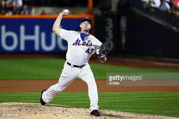 Addison Reed of the New York Mets pitches in the eighth inning against the San Francisco Giants during their National League Wild Card game at Citi...
