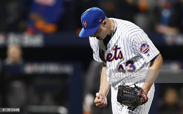 Addison Reed of the New York Mets reacts after striking out Hunter Pence of the San Francisco Giants in the eighth inning during their National...