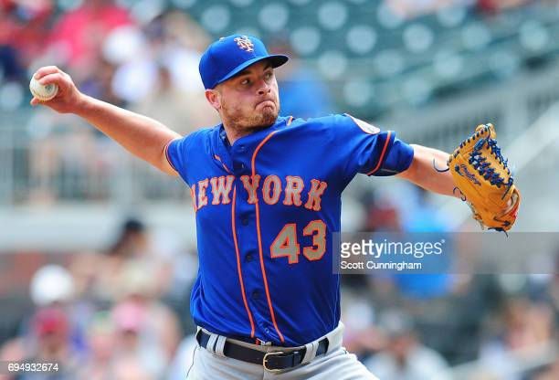 Addison Reed of the New York Mets throws a ninth inning pitch against the Atlanta Braves at SunTrust Park on June 11 2017 in Atlanta Georgia