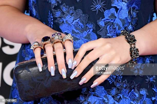 Addison Riecke jewelry and clutch detail attends Nickelodeon's 2018 Kids' Choice Awards at The Forum on March 24 2018 in Inglewood California