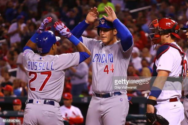 Addison Russell and Anthony Rizzo of the Chicago Cubs celebrate after Russell's threerun home run against the St Louis Cardinals in the seventh...