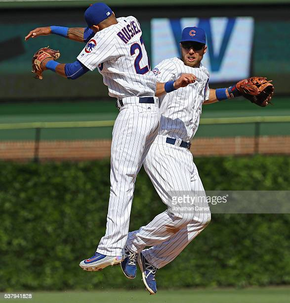 Addison Russell and Ben Zobrist of the Chicago Cubs celebrate a win over the Arizona Diamondbacks at Wrigley Field on June 3 2016 in Chicago Illinois...