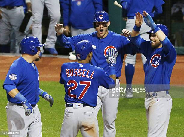 Addison Russell is congratulated by Chicago Cubs teammates after hitting a grand slam in the third inning in Game 6 of the World Series against the...