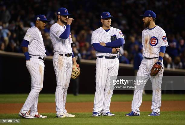 Addison Russell Kris Bryant Anthony Rizzo and Ben Zobrist of the Chicago Cubs meet during a pitching change in the sixth inning against the Los...