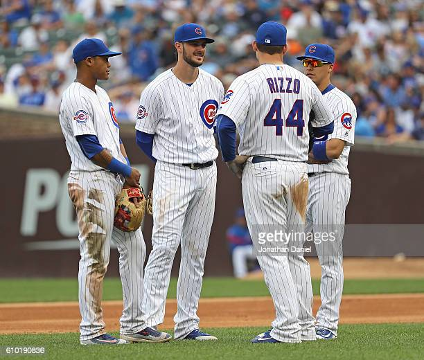 Addison Russell Kris Bryant Anthony Rizzo and Javier Baez of the Chicago Cubs chat during a pitching change against the St Louis Cardinals at Wrigley...