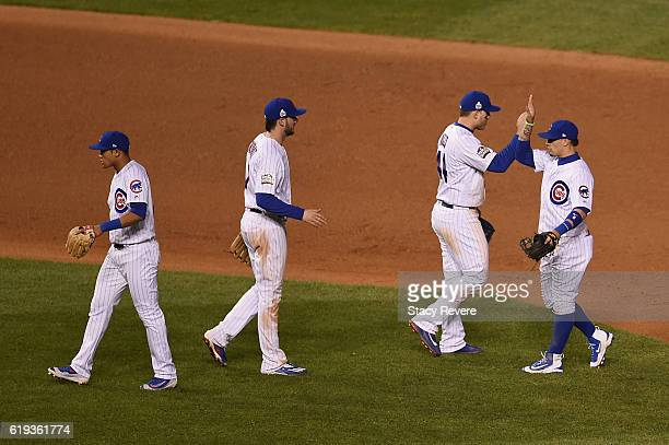 Addison Russell Kris Bryant Anthony Rizzo and Javier Baez of the Chicago Cubs celebrate after beating the Cleveland Indians 32 in Game Five of the...