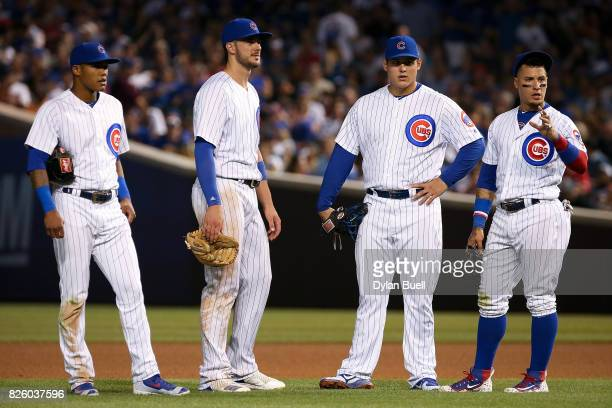 Addison Russell Kris Bryant Anthony Rizzo and Javier Baez of the Chicago Cubs stand on the field during a pitching change in the sixth inning against...