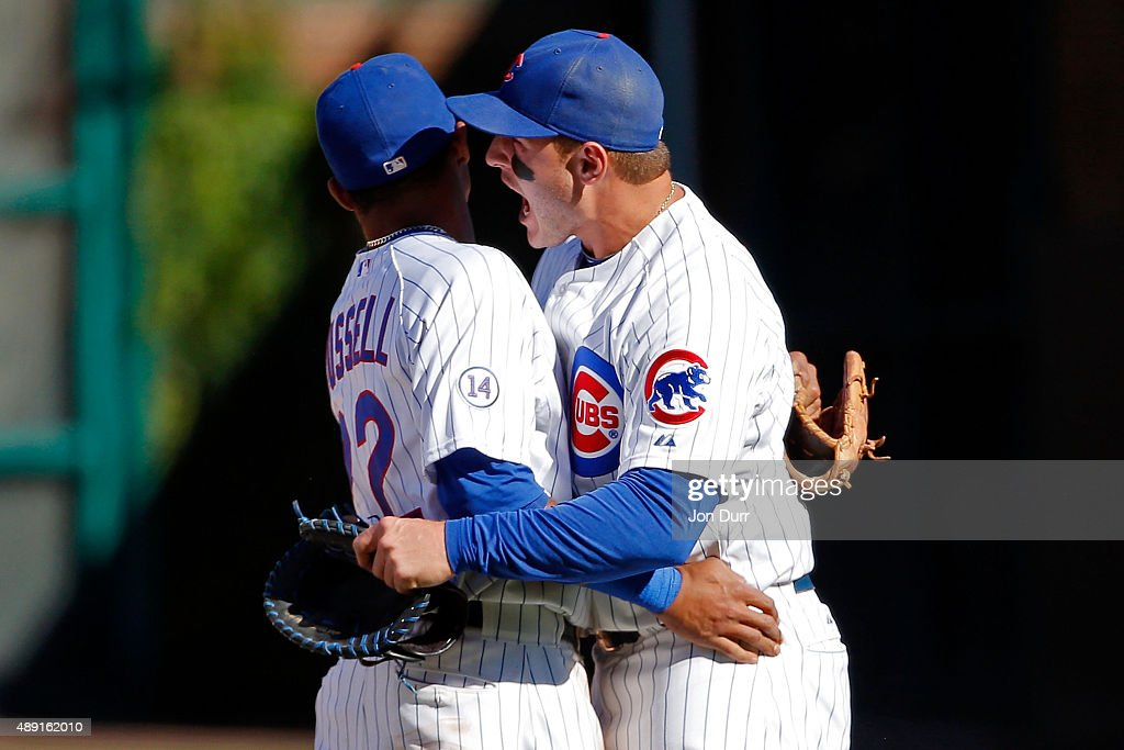 Addison Russell #22 of the Chicago Cubs (L) and Anthony Rizzo #44 celebrate their win over the St. Louis Cardinals at Wrigley Field on September 19, 2015 in Chicago, Illinois. The Chicago Cubs won 5-4.