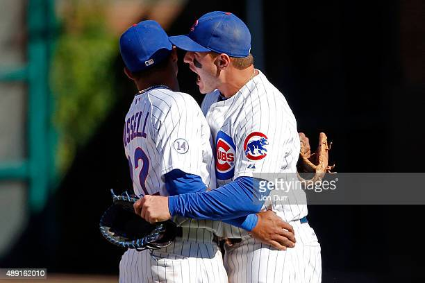 Addison Russell of the Chicago Cubs and Anthony Rizzo celebrate their win over the St Louis Cardinals at Wrigley Field on September 19 2015 in...