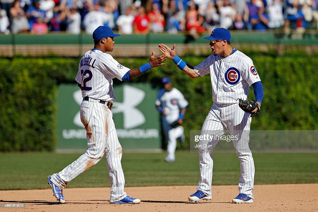 Addison Russell #22 of the Chicago Cubs (L) and Javier Baez #9 (R) celebrate their win over the St. Louis Cardinals at Wrigley Field on September 19, 2015 in Chicago, Illinois. The Chicago Cubs won 5-4.
