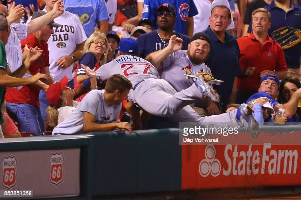 Addison Russell of the Chicago Cubs attempts to catch a foul ball against the St Louis Cardinals in the second inning at Busch Stadium on September...