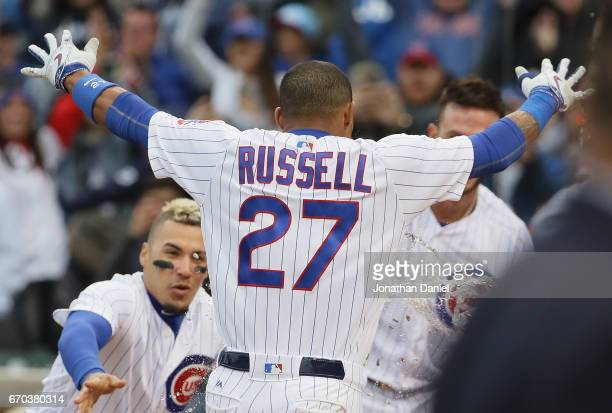 Addison Russell of the Chicago Cubs celebrates after hitting a three run walkoff home run in the bottom of the 9th inning against the Milwaukee...