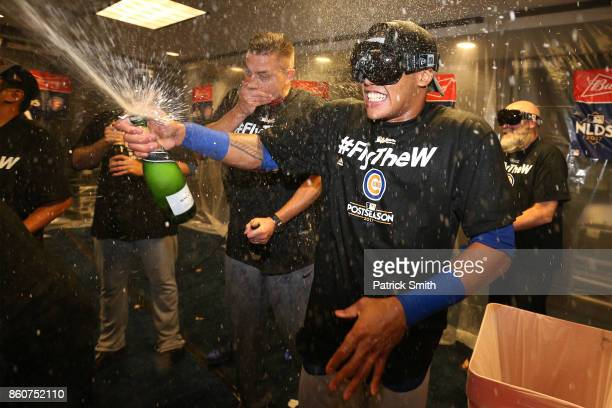 Addison Russell of the Chicago Cubs celebrates in the clubhouse with teammates after defeating the Washington Nationals 98 in game five of the...