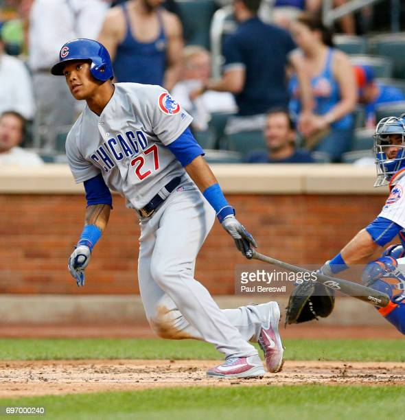 Addison Russell of the Chicago Cubs drives in two runs with a double in the second inning of an MLB baseball game against the New York Mets on June...