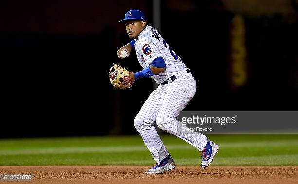 Addison Russell of the Chicago Cubs fields a ground ball in the fourth inning against the San Francisco Giants at Wrigley Field on October 7 2016 in...
