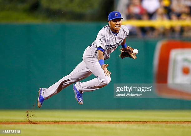 Addison Russell of the Chicago Cubs flips the ball to second base before the double play is turned against the Pittsburgh Pirates during game two of...
