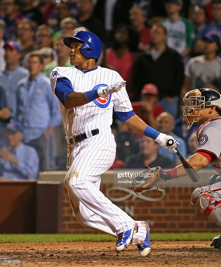 Addison Russell #22 of the Chicago Cubs gets the game-winning hit, a double off of the center field wall, in the bottom of the 9th inning against the Washington Nationals at Wrigley Field on May 26, 2015 in Chicago, Illinois. The Cubs defeated the Nationals 3-2.