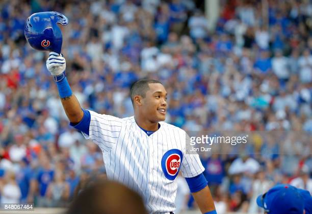Addison Russell of the Chicago Cubs gives a curtain call after hitting a home run against the St Louis Cardinals during the eighth inning at Wrigley...