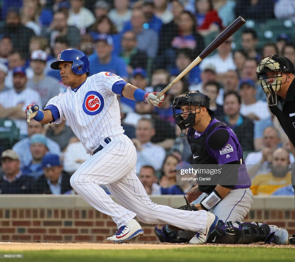 Addison Russell #27 of the Chicago Cubs hits a run scoring single in the 2nd inning against the Colorado Rockies at Wrigley Field on April 30, 2018 in Chicago, Illinois.