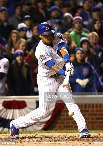 Addison Russell of the Chicago Cubs hits a single in the fourth inning against the Cleveland Indians in Game Five of the 2016 World Series at Wrigley...