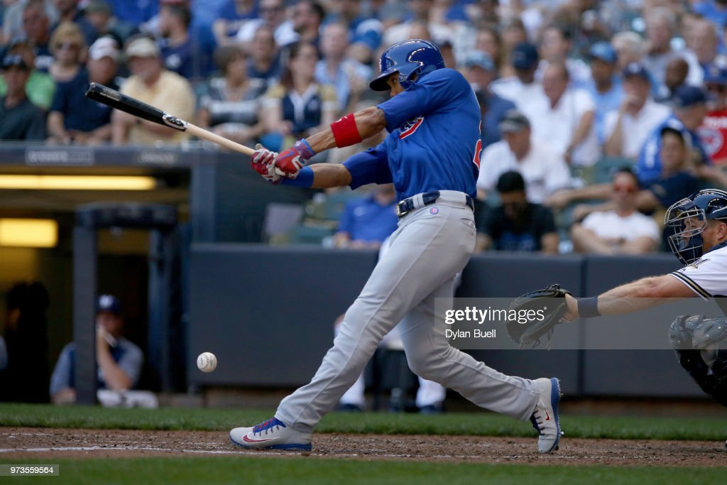 Addison Russell #27 of the Chicago Cubs hits a single in the seventh inning against the Milwaukee Brewers at Miller Park on May 27, 2018 in Milwaukee, Wisconsin.