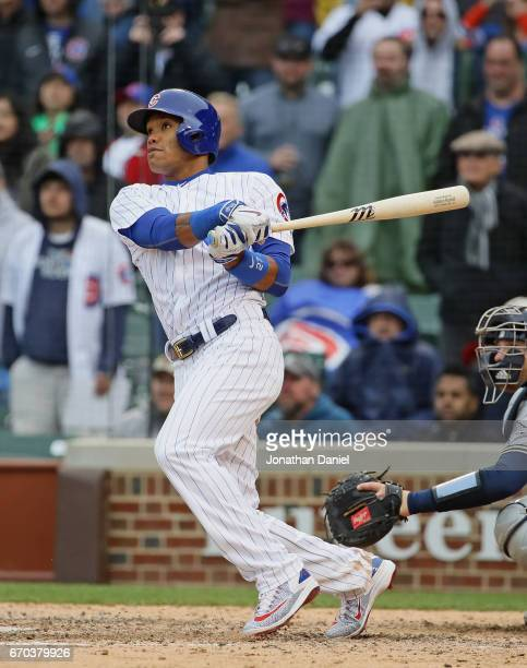 Addison Russell of the Chicago Cubs hits a three run walkoff home run in the bottom of the 9th inning against the Milwaukee Brewers at Wrigley Field...