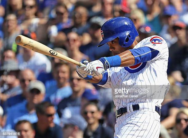Addison Russell of the Chicago Cubs hits a two run double in the 8th inning against the Arizona Diamondbacks at Wrigley Field on June 3 2016 in...
