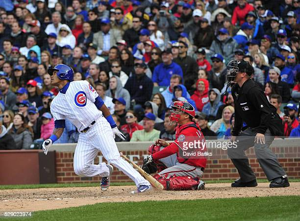 Addison Russell of the Chicago Cubs hits a twoRBI double against the Washington Nationals during the seventh inning on May 7 2016 at Wrigley Field in...