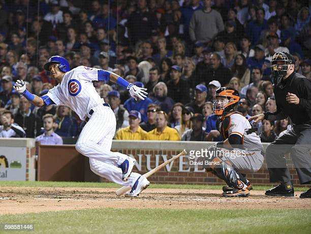 Addison Russell of the Chicago Cubs hits a twoRBI single against the San Francisco Giants during the seventh inning on September 01 2016 at Wrigley...
