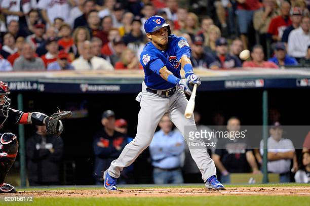 Addison Russell of the Chicago Cubs hits a tworun double in the first inning during Game 6 of the 2016 World Series against the Cleveland Indians at...