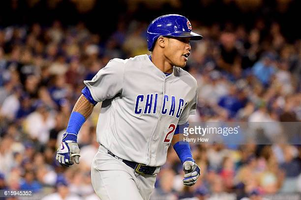 Addison Russell of the Chicago Cubs hits a tworun home run in the sixth inning against the Los Angeles Dodgers in game five of the National League...