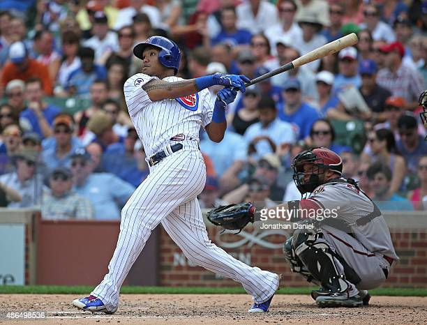 Addison Russell of the Chicago Cubs hits his second home run of the day a two run shot in the 4th inning against the Arizona Diamondbacks at Wrigley...