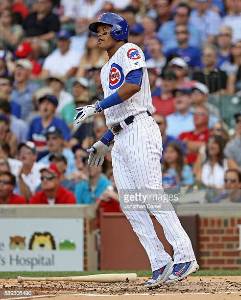 Addison Russell of the Chicago Cubs hops after hitting a two run home run in the 2nd inning against the St Louis Cardinals at Wrigley Field on August...