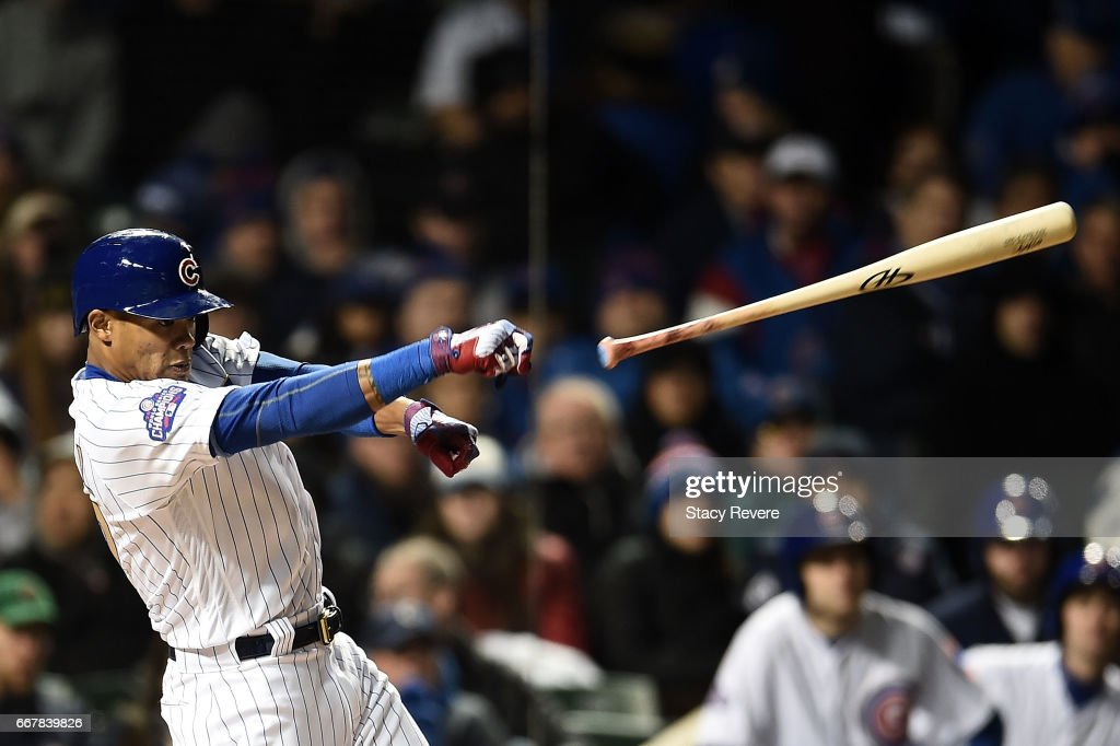 Addison Russell #27 of the Chicago Cubs loses his bat during the fourth inning of a game against the Los Angeles Dodgers at Wrigley Field on April 12, 2017 in Chicago, Illinois.