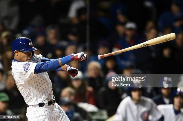 Addison Russell of the Chicago Cubs loses his bat during the fourth inning of a game against the Los Angeles Dodgers at Wrigley Field on April 12...