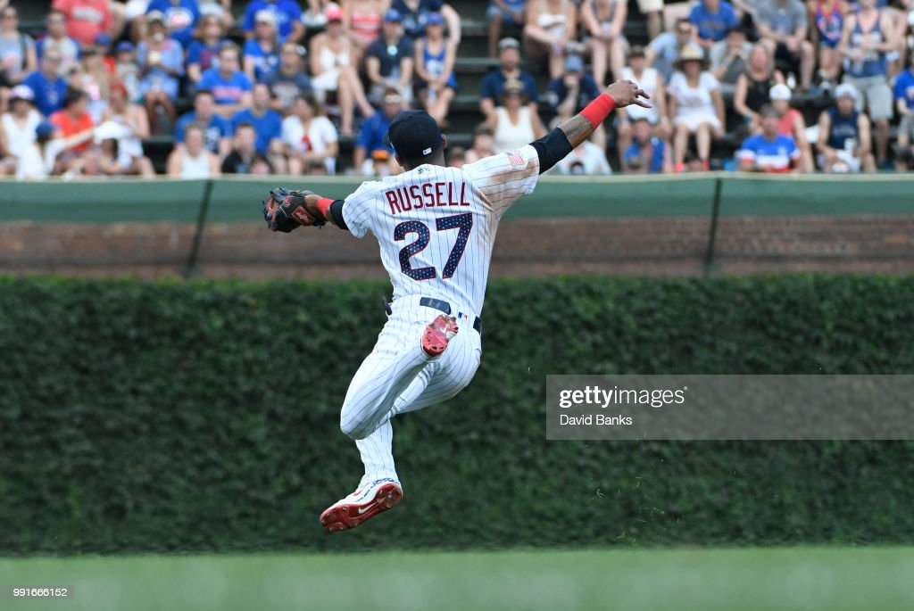 Addison Russell #27 of the Chicago Cubs makes a catch on JaCoby Jones #21 of the Detroit Tigers during the sixth inning on July 4, 2018 at Wrigley Field in Chicago, Illinois.