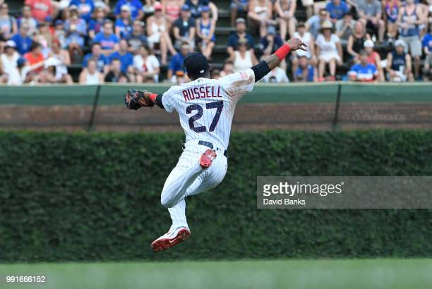 Addison Russell of the Chicago Cubs makes a catch on JaCoby Jones of the Detroit Tigers during the sixth inning on July 4 2018 at Wrigley Field in...