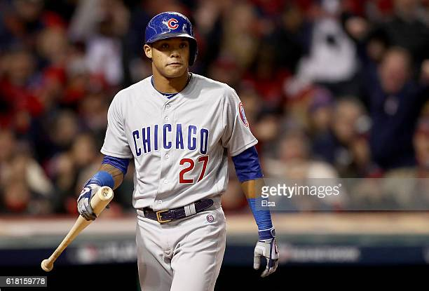 Addison Russell of the Chicago Cubs reacts after striking out in the seventh inning against the Cleveland Indians in Game One of the 2016 World...