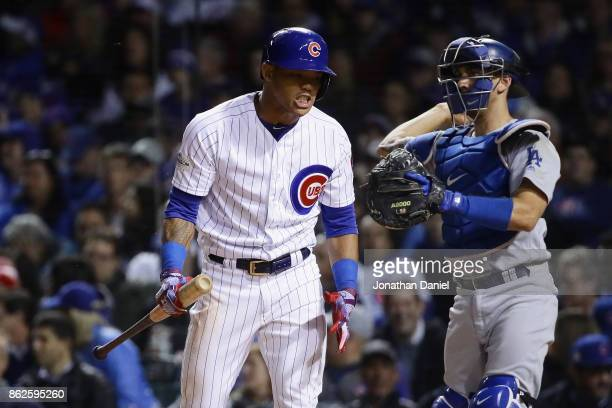 Addison Russell of the Chicago Cubs reacts after striking out in the seventh inning against the Los Angeles Dodgers during game three of the National...