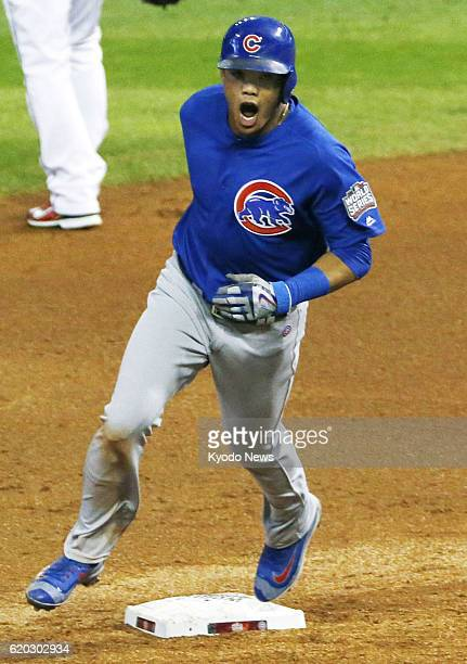 Addison Russell of the Chicago Cubs rounds the bases after hitting a grand slam in the third inning in Game 6 of the World Series against the...